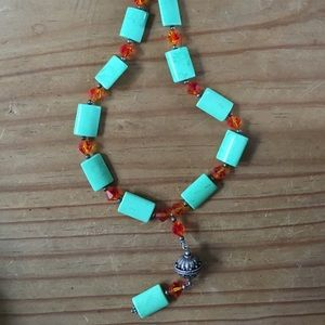 Green stone necklace with orange beads